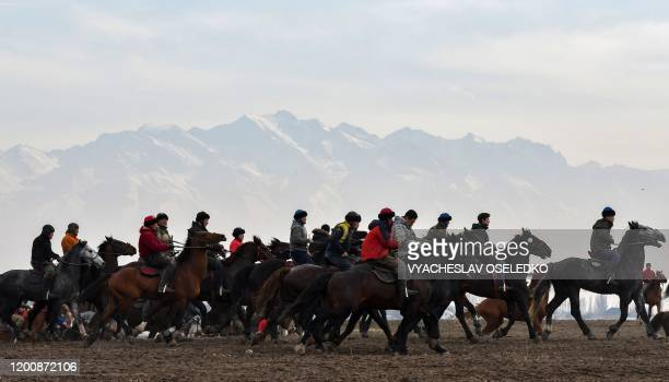 Kyrgyz riders compete during the traditional national horse game Alaman-Ulak near the village of Dacha-Suu some 30 km from Bishkek on February 15,...