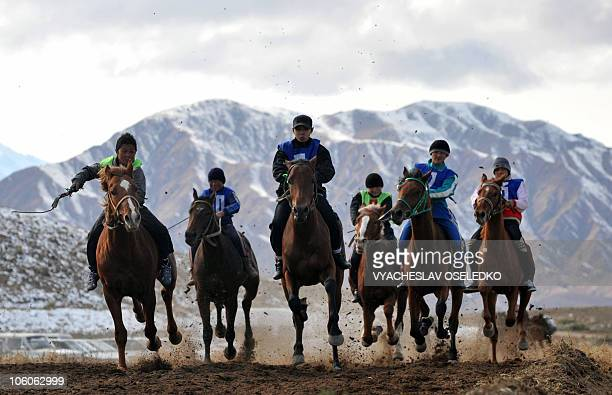 Kyrgyz riders race during the traditional 'Salburun' hunting festival in the village of Bokonbayevo some 250 km outside Biskek on October 24 2010 AFP...