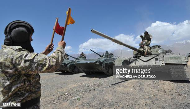Kyrgyz servicemen take part in a military exercise called 'Security2017' at the Edelweiss training area in Balykchy some 200 kms from Bishkek on...
