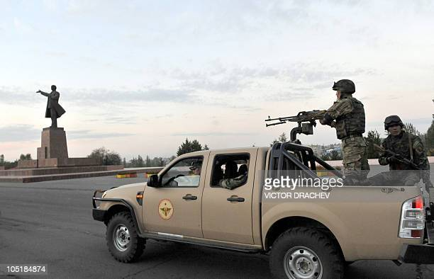 Kyrgyz soldiers patrol near a monument dedicated to Lenin, in Osh on October 9, 2010. Kyrgyzstan's parties yesterday made a final push for votes in...