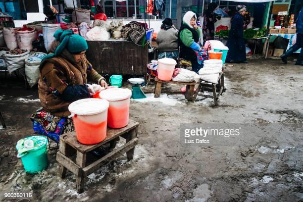 kyrgyz women at osh jayma bazaar - dafos stock photos and pictures