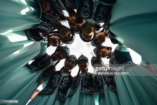 TOPSHOT Kyrgyz women wearing traditional costumes perform during the celebrations of Nowruz at the central AlaToo Square in Bishkek on March 21 2019...