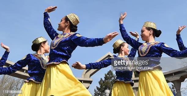Kyrgyz women wearing traditional costumes perform during the celebrations of Nowruz at the central AlaToo Square in Bishkek on March 21 2019 Nowruz...
