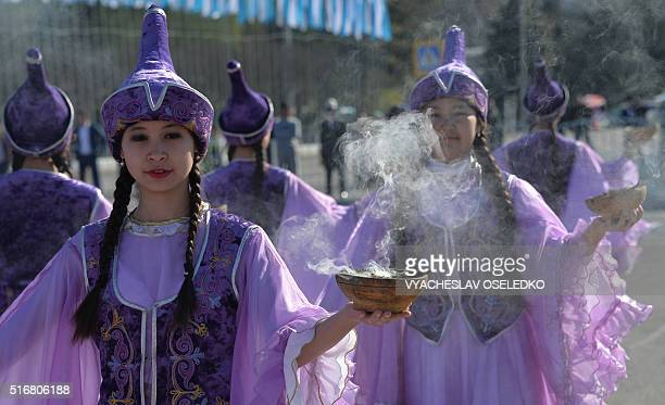 Kyrgyz women wearing traditional costumes perform during the celebrations of Nowruz at the central AlaToo Square in Bishkek on March 21 2016 Nowruz...