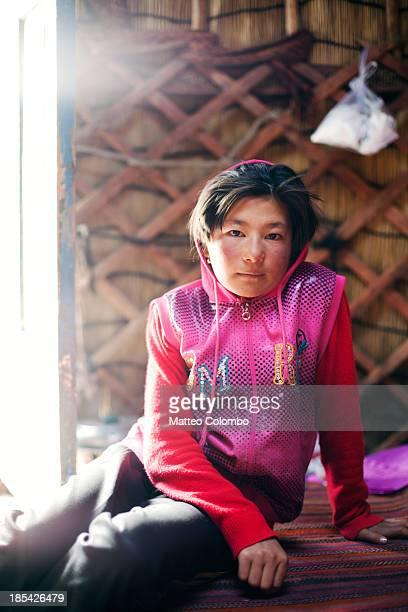 Kyrgyz young girl inside a traditional yurt