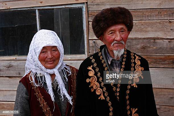 kyrgyzstan traditional clothing - kyrgyzstan stock photos and pictures