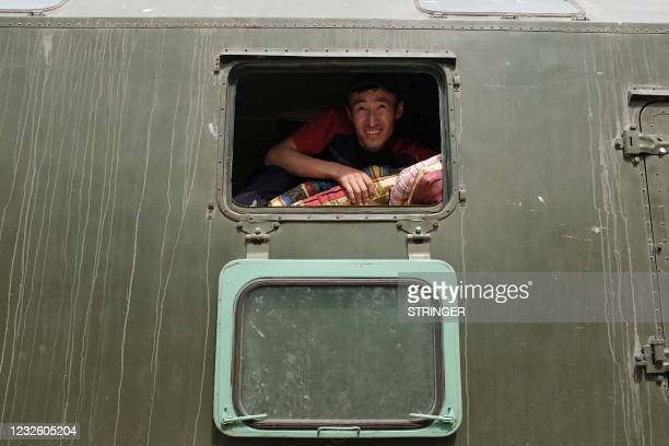 Kyrgyzstan's emergencies ministry serviceman unloads mattresses for citizens, who were evacuated from districts bordering Tajikistan following the...