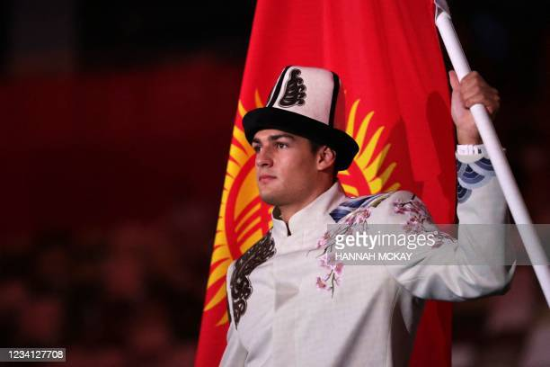 Kyrgyzstan's flag bearer Denis Petrashov leads the delegation during the Tokyo 2020 Olympic Games opening ceremony's parade of athletes, at the...