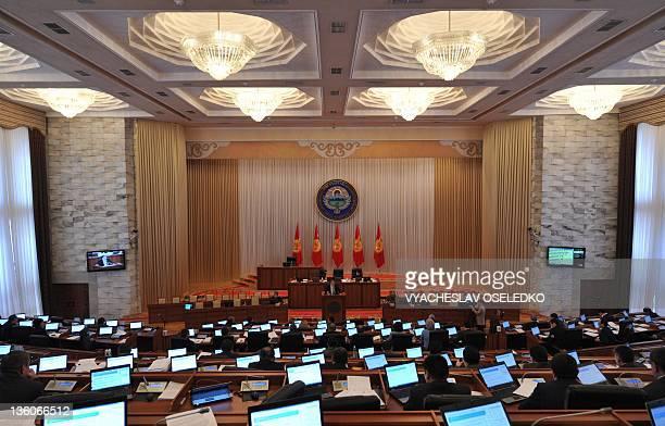 Kyrgyzstan's Parliament newly-appointed speaker, Asylbek Zheenbekov, addresses lawmakers in the parliament in Bishkek, on December 21, 2011. AFP...