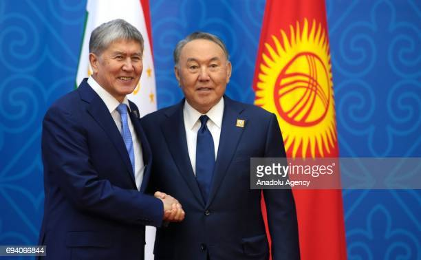 Kyrgyzstan's President Almazbek Atambayev and Kazakhstan's President Nursultan Nazarbayev shake their hands ahead of a meeting of the Shanghai...