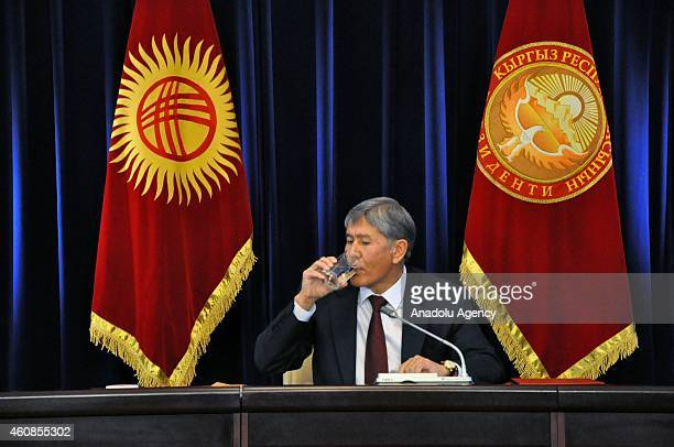Kyrgyzstan's President Almazbek Atambayev drinks water during a press conference for the yearend of the 2014 at the state residence in the capital...