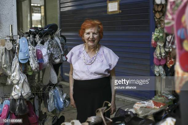 Kyria Vaso a Greek pensioner who runs a shoe store together with her son posing for the photographer in Athens Greece on July 8th 2015 Photo Socrates...