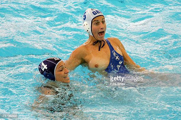 Kyriaki Liosi of Greece has her swimsuit torn by by Silvia Bosurgi of Italy in the Women's Final Round Water Polo match between Greece and Italy at...