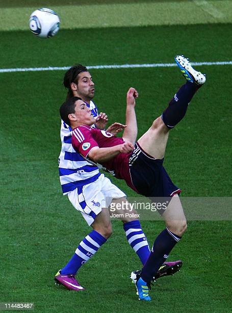 Kyriako Papadopoulus of Schalke and Olcay Sahan of Duisburg battle for the ball during the DFB Cup final match between MSV Duisburg and FC Schalke 04...