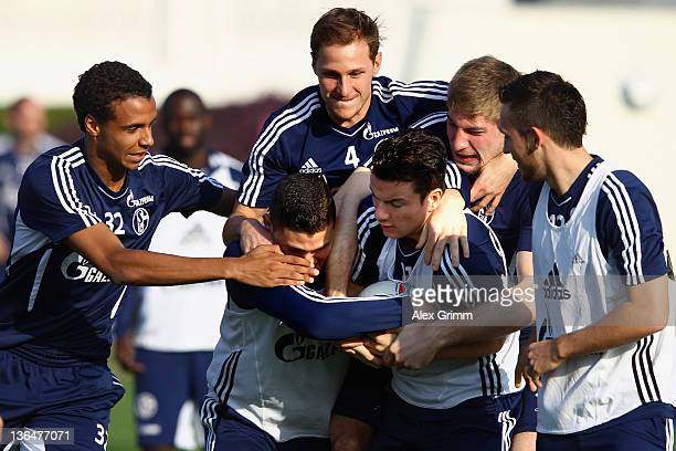 Kyriakos Papadopoulos Alexander Baumjohann Joel Matip Benedikt Hoewedes Lars Unnerstall and Marco Hoeger fight for the ball during a training session...