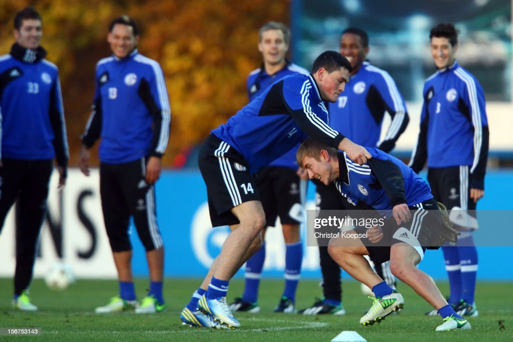 Kyriakos Papadopoulos and Lewis Holtby of Schalke 04 attend the training session at the training ground ahead of the UEFA Champions League group B match between FC Schalke 04 and Olympiakos Piraeus on November 21, 2012 in Gelsenkirchen, Germany.