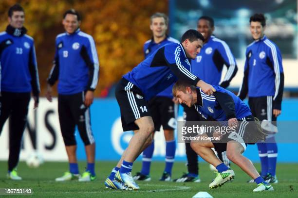 Kyriakos Papadopoulos and Lewis Holtby of Schalke 04 attend the training session at the training ground ahead of the UEFA Champions League group B...