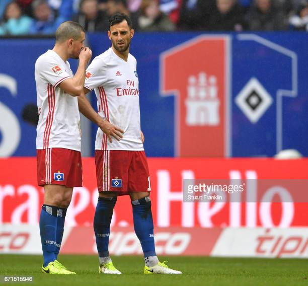Kyriakos Papadopoulos and Mrgim Mavraj of Hamburg look dejected during the Bundesliga match between Hamburger SV and SV Darmstadt 98 at...