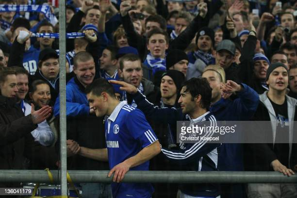 Kyriakos Papadopoulos and Raul Gonzalez of Schalke celebrate wit the fans after the Bundesliga match between FC Schalke 04 and SV Werder Bremen at...