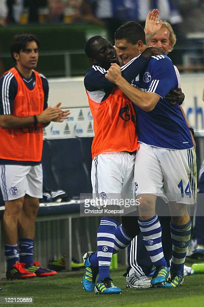 Kyriakos Papadopoulos celebrates the forth goal with Hans Sarpei during the UEFA Europa League playoff second leg match between FC Schalke and HJK...