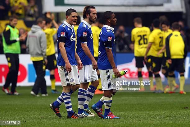 Kyriakos Papadopoulos Christian Fuchs and Jefferson Farfan of Schalke look dejected after losing 12 the Bundesliga match between FC Schalke 04 and...
