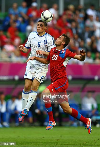 Kyriakos Papadopoulos of Greece and Tomas Pekhart of Czech Republic compete for the ball during the UEFA EURO 2012 group A match between Greece and...