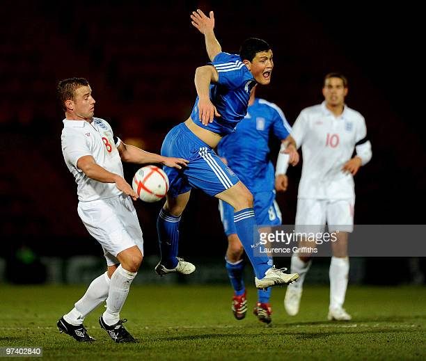 Kyriakos Papadopoulos of Greece battles with Lee Cattermole of England during the UEFA Under 21 Championship Qualifying match between England and...