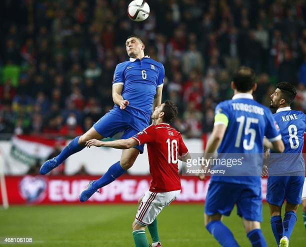 Kyriakos Papadopoulos of Greece fights for the ball with Zoltan Gera of HUngary during Hungary v Greece European Euro 2016 qualification soccer match...