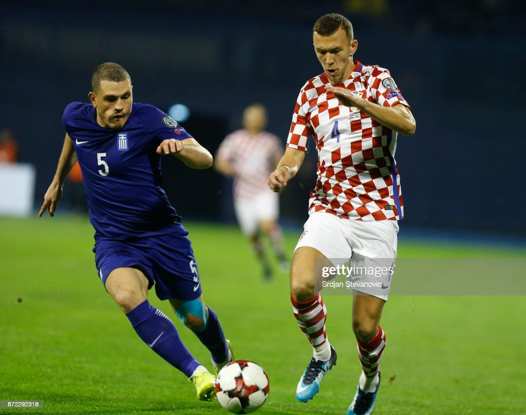 Kyriakos Papadopoulos (L) of Greece is challenged by Ivan Perisic (R) of Croatia during the FIFA 2018 World Cup Qualifier Play-Off: First Leg between Croatia and Greece at Stadion Maksimir on November 9, 2017 in Zagreb, Croatia