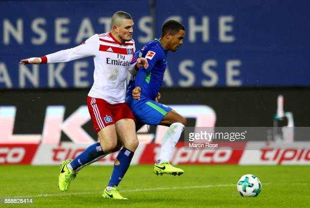 Kyriakos Papadopoulos of Hamburg and Daniel Didavi of Wolfsburg battle for the ball during the Bundesliga match between Hamburger SV and VfL...