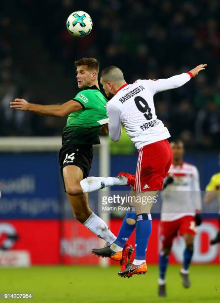 Kyriakos Papadopoulos of Hamburg and Niclas Fuellkrug of Hannover battle for the ball during the Bundesliga match between Hamburger SV and Hannover...