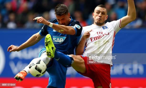 Kyriakos Papadopoulos of Hamburg and Sandro Wagner of Hoffenheim battle for the ball during the Bundesliga match between Hamburger SV and TSG 1899...