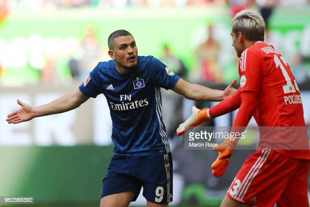 Kyriakos Papadopoulos of Hamburg argues with goalkeeper Julian Pollersbeck of Hamburg after Wolfsburg sacred a goal to make it 12 during the...