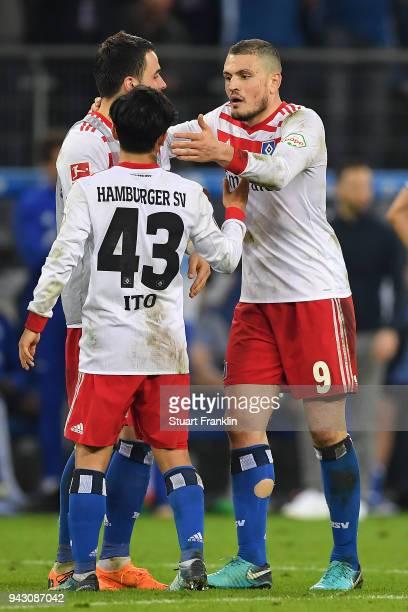Kyriakos Papadopoulos of Hamburg celebrates with Tatsuya Ito of Hamburg during the Bundesliga match between Hamburger SV and FC Schalke 04 at...