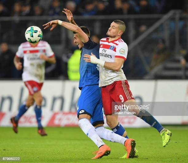 Kyriakos Papadopoulos of Hamburg challenges Sandro Wagner of Hoffenheim during the Bundesliga match between Hamburger SV and TSG 1899 Hoffenheim at...