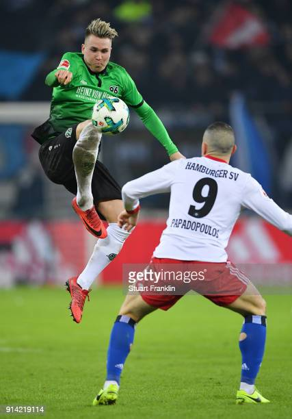 Kyriakos Papadopoulos of Hamburg is challenged by Felix Klaus of Hannover during the Bundesliga match between Hamburger SV and Hannover 96 at...
