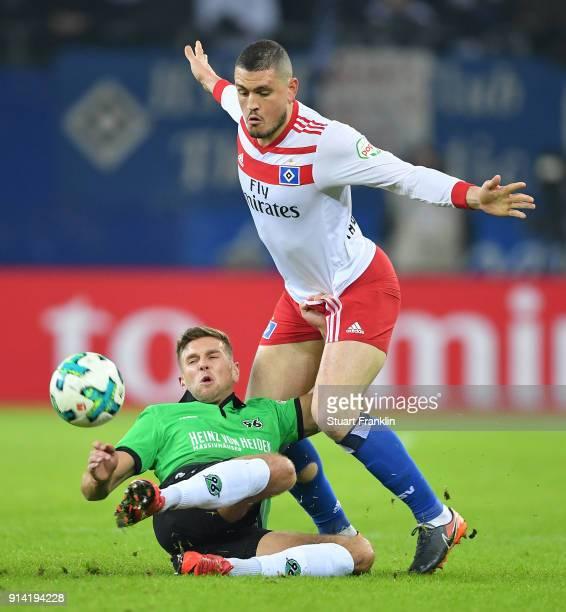 Kyriakos Papadopoulos of Hamburg is challenged by Niclas FŸllkrug of Hannover during the Bundesliga match between Hamburger SV and Hannover 96 at...