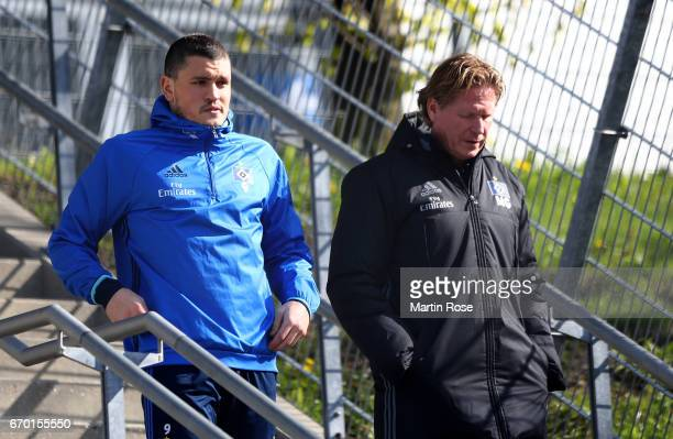 Kyriakos Papadopoulos of Hamburg talks to head coach Markus Gisdol during a training session of Hamburger SV at Volksparkstadio on April 19, 2017 in...