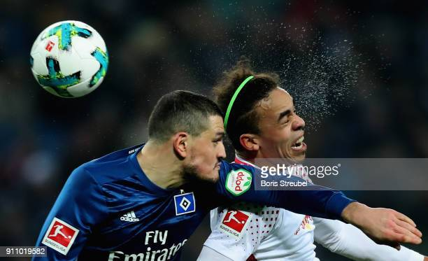 Kyriakos Papadopoulos of Hamburger SV jumps for a header with Yussuf Poulsen of RB Leipzig during the Bundesliga match between RB Leipzig and...