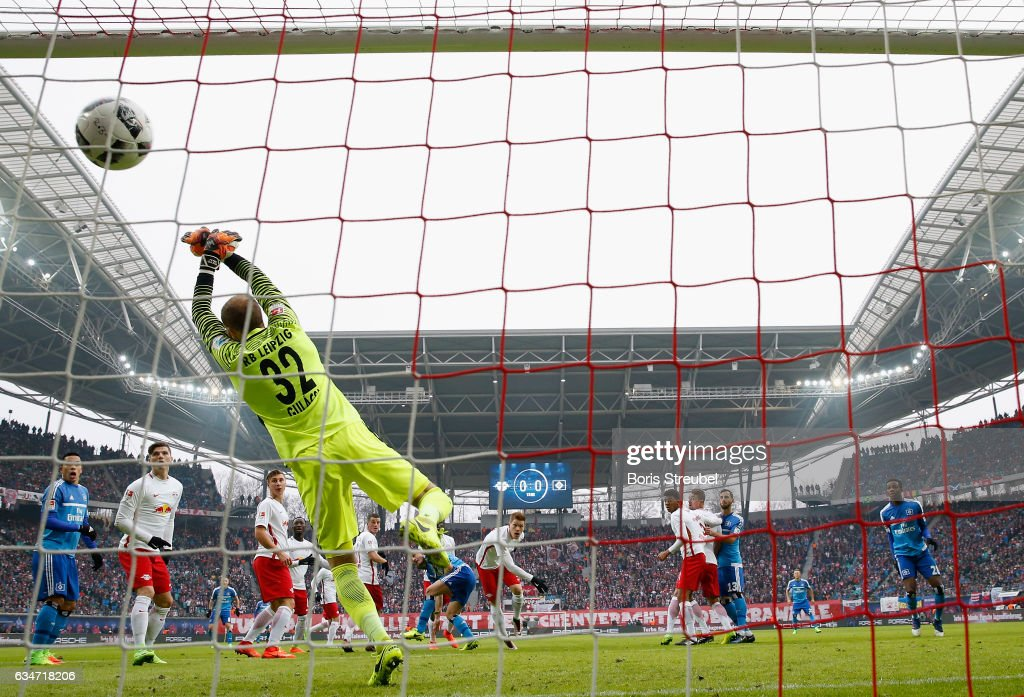 Kyriakos Papadopoulos (C) of Hamburger SV scores his team's first goal with a header against goalkeeper Peter Gulacsi of RB Leipzig during the Bundesliga match between RB Leipzig and Hamburger SV at Red Bull Arena on February 11, 2017 in Leipzig, Germany.