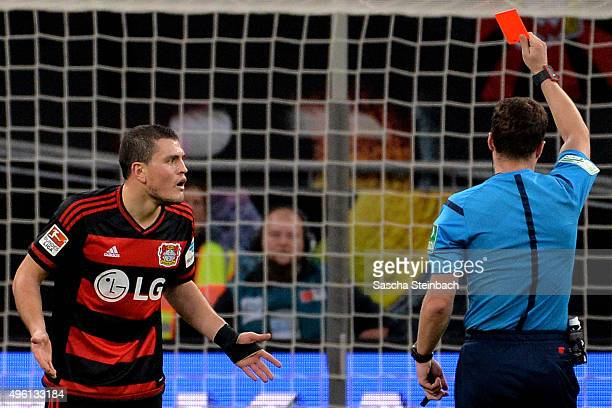 Kyriakos Papadopoulos of Leverkusen is booked red card by referee Felix Zwayer during the Bundesliga match between Bayer Leverkusen and 1 FC Koeln at...