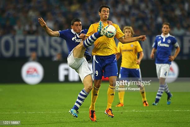 Kyriakos Papadopoulos of Schalke challenges Beart Sadik of Helsinki during the UEFA Europa League play-off second leg match between FC Schalke and...