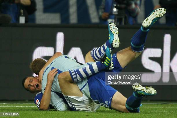 Kyriakos Papadopoulos of Schalke embraces Ralf Faehrmann after saving the decision penalty during the Supercup match between FC Schalke 04 and...