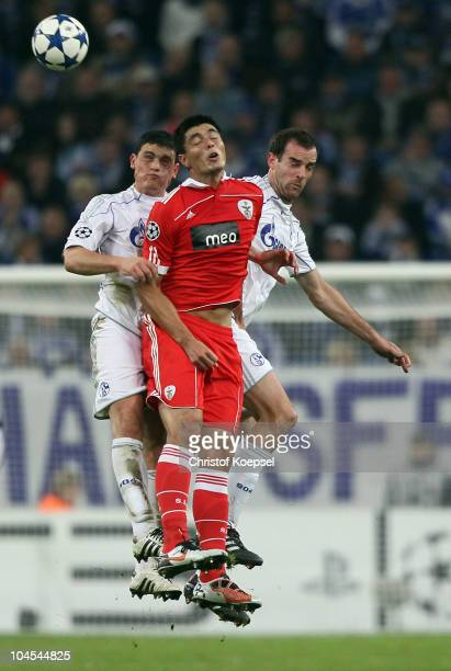 Kyriakos Papadopoulos of Schalke, Oscar Cardozo of Benfica and Christoph Metzelder of Schalke go up for a header during the UEFA Champions League...