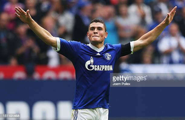 Kyriakos Papadopoulos of Schlake celebrates after scoring his tem's first goal during the Bundesliga match between FC Schalke 04 and FC Augsburg at...