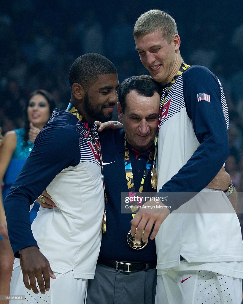Kyrie A. Irving (L) of the USA and his teammate Mason Plumlee (R) embraces their head coach Mike Krzyzewski (2ndL) during the 2014 FIBA World Basketball Championship final match between USA and Serbia at Palacio de los Deportes on September 14, 2014 in Madrid, Spain.