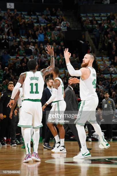 Kyrie Irving and Aron Baynes of the Boston Celtics react against the Atlanta Hawks on December 14 2018 at the TD Garden in Boston Massachusetts NOTE...