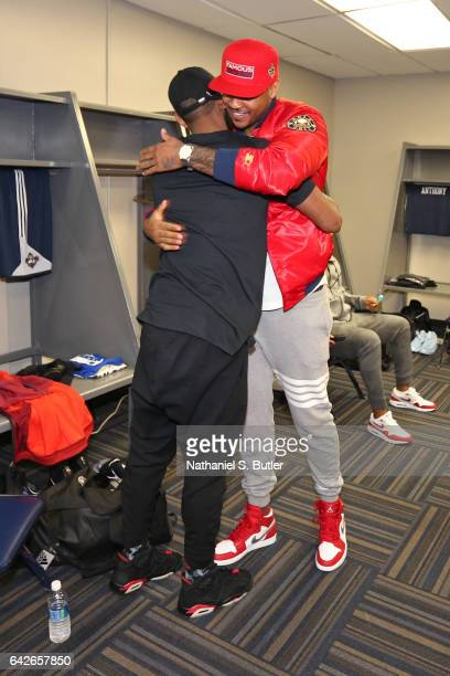 Kyrie Irving and Carmelo Anthony of the Eastern Conference All Star Team hug before NBA AllStar Practice as part of 2017 AllStar Weekend at the...