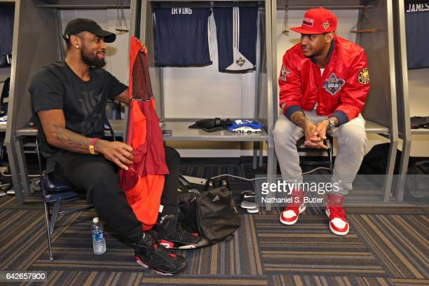 Kyrie Irving and Carmelo Anthony of the Eastern Conference All Star Team talk before NBA AllStar Practice as part of 2017 AllStar Weekend at the...