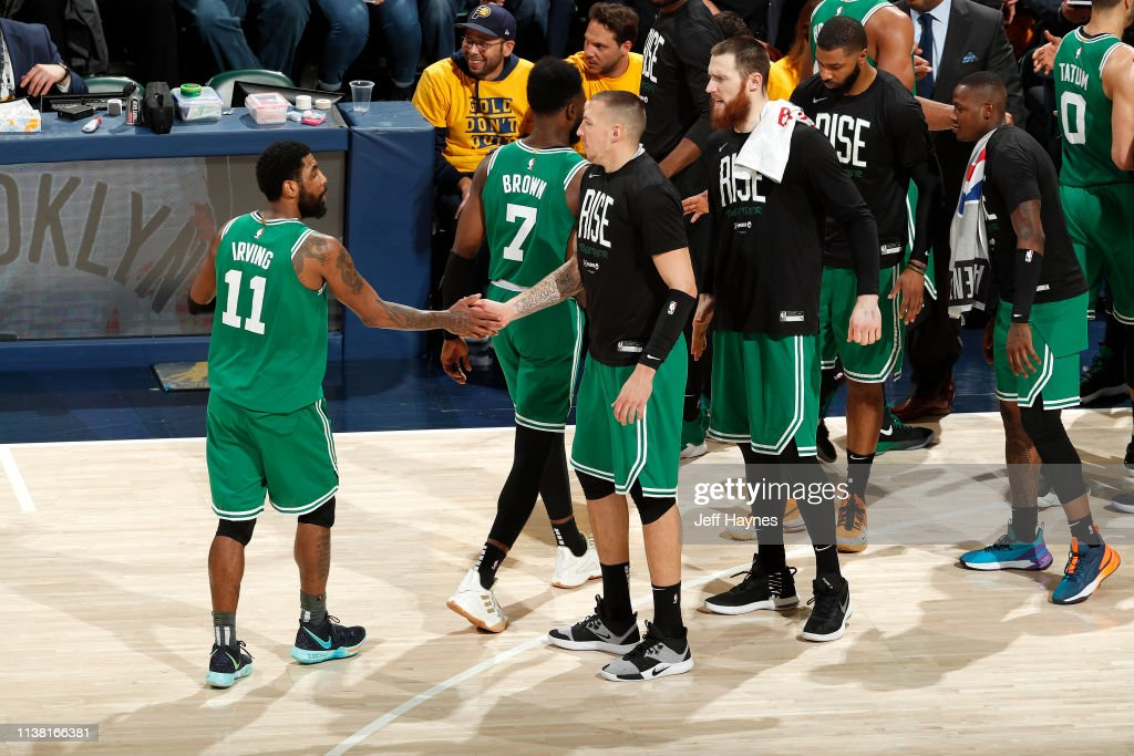 low priced f3c31 99e33 Kyrie Irving and Daniel Theis of the Boston Celtics high ...